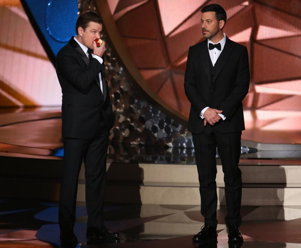 Actor Damon jokes around with show host Kimmel at the 68th Primetime Emmy Awards in Los Angeles